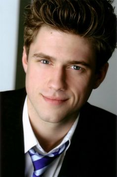 Aaron Tveit---plays Enjolras in the film version of Les Miserables. I like him better with curly hair, but that's me ;)