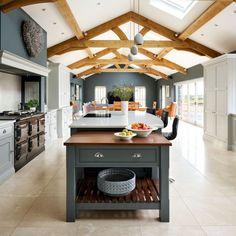 kitchen, spacious, tiled flooring, beam, wooden worktop, silestone worktop, range cooker, cooker hood, sink, tap, tiled flooring, cabinetry, long, spacious