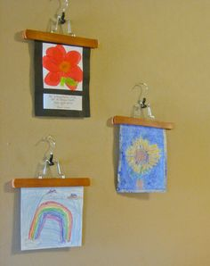 Use Pants Hangers to display, and easily change out, kids' drawings (image via Amy Bayliss)