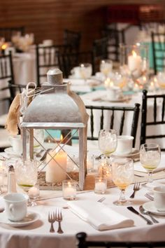 Lantern centerpiece: filled with flowers and fruit OR candles inside floral and fruit around.