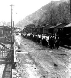 Coal mining town of Dehue, West Virginia showing a 1934 labor march.