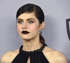 Striking look: The 31-year-old star completed her dramatic look with a deep berry lip colo...