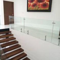Pasillo, hall y escalera: Pasillo, hall y escaleras de estilo translation missing: mx.style.pasillo-hall-y-escaleras.moderno por AParquitectos