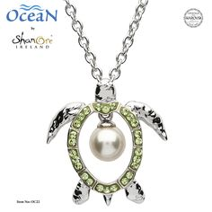 Sparkling peridot green crystals from Swarovski® frame a solitary dangling pearl by Swarovski in this sterling silver turtle pendant from The Ocean Collection by Shanore Ireland. Silver Pearls, Swarovski Pearls, Ocean Jewelry, Jewelry Tattoo, Pearl Pendant Necklace, Peridot, Jewelry Stores, Jewelry Collection, Sterling Silver