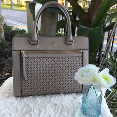 Kate Spade Romy Handbag NWT ✨ Kate Spade Romy Handbag. Color: Warmputty (brown/grey color). Includes removable shoulder strap. Magnetic top closure with dividing zipper pocket, double slide pockets, and gold hardware.  authentic. Suggested wallet is NOT included in this price, wallet is sold separately. Bundle to save! Offers are welcome  kate spade Bags Satchels