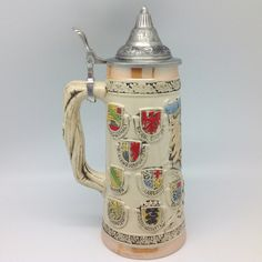 German Coat of Arms Ceramic Stein with metal lid. Engraved beer stein makes for a great classic gift or decorative accent. www.GermanGiftOutlet.com
