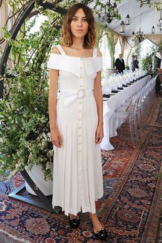 Alexa Chung wearing Charlotte Olympia Kitty Embroidered Velvet Flats and Alessandra Rich Off-the-Shoulder Silk Crepe De Chine Dress