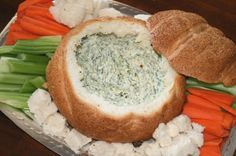 Spinach Cob Loaf -       1 cup Sour Cream     1 cup Mayonnaise     1 x 250 gram Frozen Spinach     1 Onion - finely chopped     1 packet Spring Vegetable Soup     1 Cob Loaf
