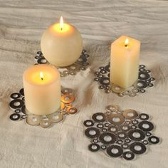 If you're looking for DIY budget home decor, look no further than your tool box. You can recycle a bunch of old washers to make these beautiful, wintery home accents. Snowflake coasters from washers make great Christmas party decorations on the cheap.