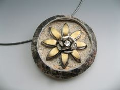 brooch of polymer clay and vintage flower components by Stonehouse Studio