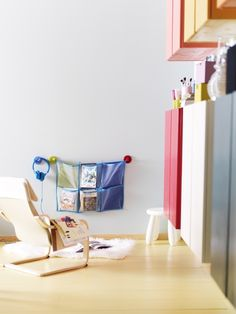Storage doesn't have to be big and square. It helps just as much if it's fun and tiny.