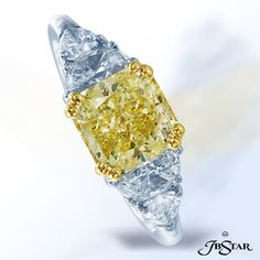 Style 2012 Natural fancy yellow diamond ring featuring an amazing 2.00ct fancy yellow radiant diamond embraced by half moon and shield diamonds in a classic three-stone setting. Platinum/18KY #yellowdiamondring #diamondring #engagementring
