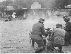 WWII German military executing what looks like civilians.