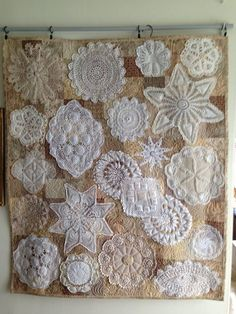 "How adorable is this doily wall hanging? Terry pieced 4"" squares for the background, used muslin on the back and stitched the doilies around the edge. Then she ""Mctavished"" around the doilies. Terrific work, Terry!"