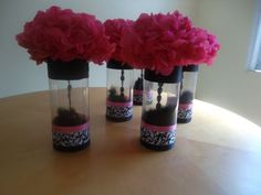 Cute. Tissue paper flowers with a sting of beads hanging in the vase.