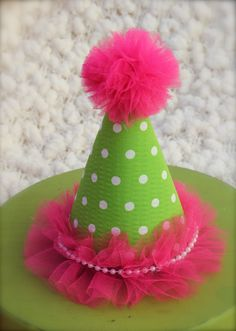 Mod Monkey Inspired Pink and Lime Green Polka Dotted Fabric Birthday Party Hat / Headband. $13.95, via Etsy.