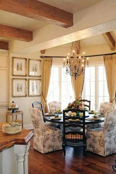 I want to knock out the wall between my kitchen and dining room and make a French country kitchen with this table and chair setting in front of my bay window.