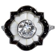 Old European  Cut Diamond Black and White Onyx Ring | From a unique collection of vintage engagement rings at https://www.1stdibs.com/jewelry/rings/engagement-rings/