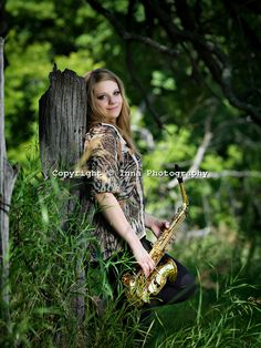 High School Senior at Inna Photography outdoor studio plays her saxophone for her high school senior pictures.
