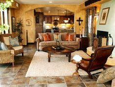 mexican-living-room-with-ceramic-tiles-floor- carpet-classic-furnitures-round-wooden-table-orange-table-and-decorations