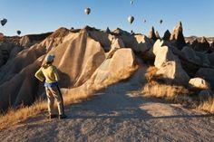 Hot air balloon over rock formations in Cappadocia, Turkey Stock Photo