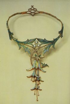 Gorgeous Art Nouveau-style necklace designed by Alphonse Mucha and made by jeweler Georges Fouquet, 1905. Opal, cabochon sapphire, pearl, and gold.