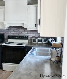 DIY kitchen remodel with painted kitchen cabinets. Formica countertops covered  with concrete. Love it.
