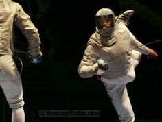 [ID: a sabre fencer doing a flunge or something.]    Gianpiero Pastore. He's fencing Nicolas Limbach