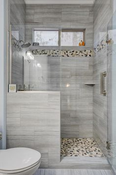 Grey marble inspired shower designed by our bathroom contractor in Henderson. Small Bathroom Tiles, Small Bathroom With Shower, Master Bathroom Shower, Modern Bathroom Design, Shower Accent Tile, Diy Bathroom Remodel, Bathroom Remodeling, Bathroom Gallery, Las Vegas
