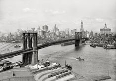 "New York circa 1915. ""Brooklyn Bridge, East River and skyline."" The Woolworth Building stars in this Lower Manhattan view, with the Singer, Bankers Trust, Hudson Terminal, Municipal and Park Row buildings as understudies."
