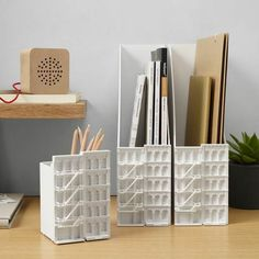 Not your average plastic file corral. This one was inspired by the 19th-century cast-iron buildings of New York City's SoHo neighborhood. | Archi Desk Accessories File Holder from @momadesignstore