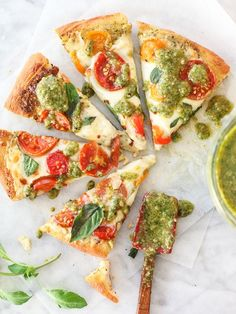 Pesto Pizza with Fresh Tomatoes and Mozzarella on foodiecrush.com