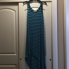Michael Kors Striped Asymmetrical Dress Michael Kors striped asymmetrical dress. Light blue and black stripes. Size medium. Runs slightly larger. I was technically a size large when I bought this, but medium fit. Really cute and flattering! Plate on the back started to come off. You can either stitch it back on or just remove it. Not noticeable because hair covers it. Michael Kors Dresses Asymmetrical