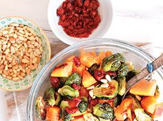 The best Roasted Brussels Sprouts with Butternut Squash, Cranberries, and Pine Nuts. From the Yummy Mummy Kitchen cookbook.  Perfect Thanksgiving side dish! #Thanksgiving