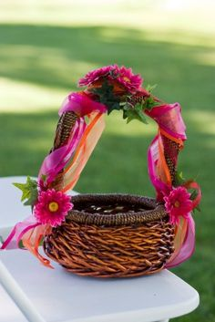 wicker flower girl basket | Fuchsia and orange ribbons in this brown basket. Hot pink daisies and ...