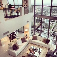 upstairs. downstairs. room with a view. penthouse suite. floor to ceiling glass.