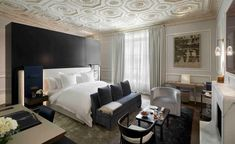 Best-known for its clutch of villas and residences in affluent destinations from London's Belgravia to St. Barth's, so it's no surprise that – for its first hotel offering – The Collection has pulled out all the stops, landing in Paris' Golden Triangle, one street over from Avenue Montaigne. With just 11 rooms, suites and apartments, the intimate property occupies a grand three-storey neoclassical pile originally built in 1908 for Maurice Villeroy, the family that founded Villeroy & Boch. White Bedroom Furniture, Luxury Furniture, Custom Made Furniture, Furniture Making, Suite Room Hotel, Marble Fireplaces, House Restaurant, Furniture Styles, Mansions