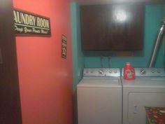 Our rental laundry room after. Orange and teal