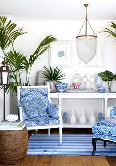 Natalee had antique armchairs repainted and upholstered in blue-and-white fabrics that reference her collection of classic ceramics. Rattan stools from Mandalay Designs. | Photo: Angelita Bonetti | Story: Australian House & Garden
