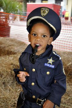 The French Market's Boo Carre Harvest Festival in New Orleans. Happy Policeman.