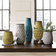 Hive Vases - What says summertime more than stunning hue of turquoise and yellow? I'd like to use these beautiful vases for an outdoor soire...