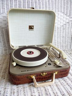 RCA Victor Portable Record Player in Faux Croco Case. my Dad had one of these and gave it to me for Christmas when my family didn't have enough money to buy one. Those Were The Days, The Good Old Days, My Childhood Memories, Great Memories, Vintage Tv, Portable Record Player, Musica Disco, Lps, Radios