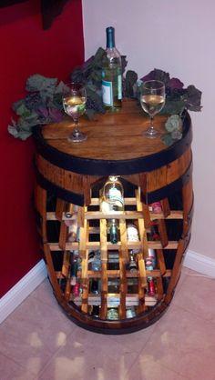 Super cute wine rack idea  Wine barrel wine rack.. $500.00, via Etsy.