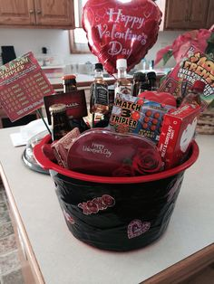 Valentines day basket for him! I used 6 IPA beers, different whiskey shots, lottery tickets, a movie theater gift card, and a lot of chocolate! I put a foam flower holder in the bottom of the basket so I could stick the items into it, and they stay nicely in place.