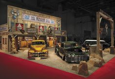To promote its new water-based paint, PPG Automotive Refinish devised the Watering Hole saloon, a rustic 2,000-square-foot exhibit featuring a desert landscape. Clever details such as cow hides and tumbleweeds provided authenticity, while PPG's paint products appeared on eye-catching objects, including everything from guitars and double basses to motorcycles and vinyl records.