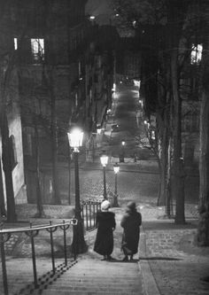 Pair of prostitutes descending stairs after dark in Montmartre. Photograph by Alfred Eisenstaedt. Paris, 1930.
