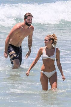 Miley Cyrus Makes a Splash in Skimpy White Bikini While on Beach Date with Love Liam Hemsworth