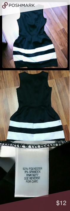 Super cute black and white dress! No zippers or buttons. Slips right on and doesn't wrinkle! Worn once, to work event. Perfect condition. Apt. 9 Dresses Midi