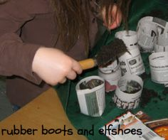 Planting seeds in make your own newspaper containers.