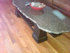 How to make a 100 dollar table. granite top (scrap from a local counter top store) trim around the legs, book shelf underneath, stained edges, painted then used paint thinner on edges.distressed wood for a rustic look. Granite Coffee Table, Granite Table Top, Granite Tops, Granite Slab, White Granite, Marble Countertops, Rustic Table, Diy Table, Rustic Furniture